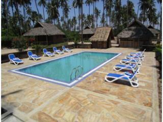 Barry's Beach Resort consists of seven unique self - Pangani vacation rentals