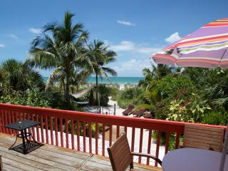 "Charming Gulffront ""on the beach"" Coquina Cottage and amazing tropical beach gardens. - Captiva Island vacation rentals"