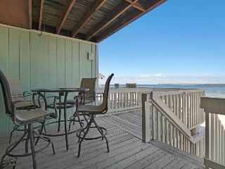 Lovely condo with bayfront views, shared pool - walk to the beach! - Gulf Breeze vacation rentals