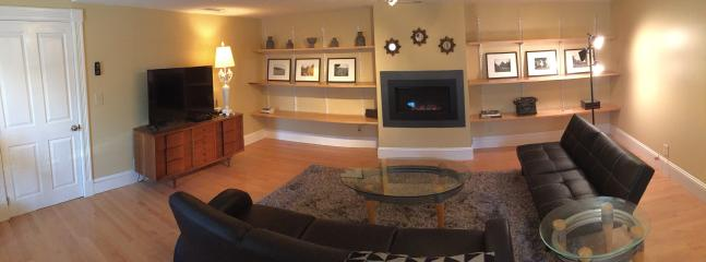 Living room with flat screen TV, fireplace, bar area, and desk area. - Hip New Saratoga Carriage House Apt close to all - Saratoga Springs - rentals