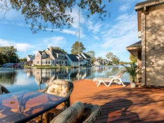 New Listing! Charming 2BR Waterfront Syracuse House w/Large Private Deck, Terrific Lake Views, 5 Kayaks & Paddle Boat Provided - Just 1 Minute from Lake Wawasee via Channel! - Syracuse vacation rentals