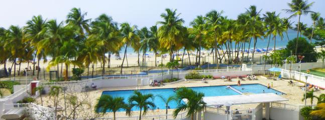 View from balcony. Pool and beach are right in front. - Get Enchanted with the Sounds of the Sea - Isla Verde - rentals