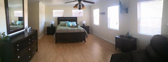 Grand Master Bedroom with Bathroom - Space Coast Home Rental - Titusville - rentals