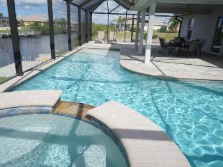 Marianne - Cape Coral 4br/2ba home w/electric and solar heated pool/spa, gulf access canal, HSW Internet, boat dock - Matlacha vacation rentals