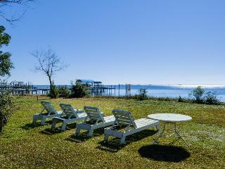 Lovely cottage w/ a gorgeous porch & nearby dock. On the Sound! - Gulf Breeze vacation rentals