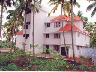 Indeevaram Apartment R1 with sea view over trees. - Kovalam vacation rentals