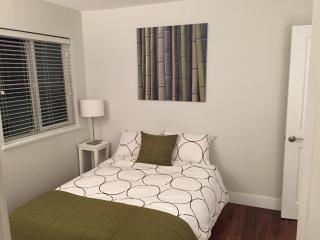 Furnished bedroom in spacious home - Vancouver vacation rentals