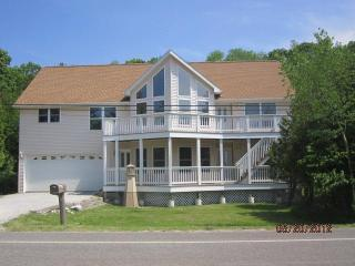 Portage Point Home with Sandy Lake Frontage - Onekama vacation rentals