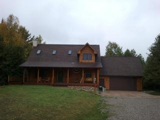 Cozy Newer Log Home backs on to Boyne River - Boyne Falls vacation rentals