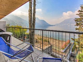 Dog-friendly condo with a balcony, lake views, and shared tennis, docks & pool! - Como vacation rentals