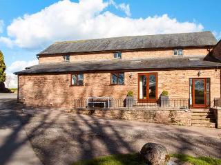 TEAL BARN, single-storey pet friendly barn conversion by lake, St Weonards Ref 933878 - Ross-on-Wye vacation rentals
