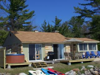 Sunrise Sunsation Lakeshore Cottage wirh HOT TUB! - Topinabee vacation rentals