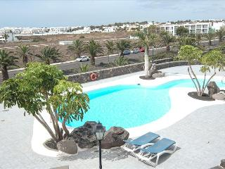 Comfortable Condo with Water Views and Shared Outdoor Pool in Costa Teguise - Costa Teguise vacation rentals