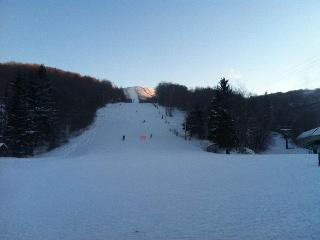 See the slopes from this cozy ski-in/ski-out townhome with shared pool & hot tub - Killington vacation rentals