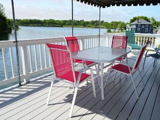 Afternoon Delight: Toast the beauty of the river from the waterfront deck - Beverly vacation rentals