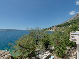 Top apartment right at the sea - Mimice vacation rentals