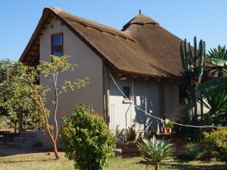 2-3 bed thatched cottage in beautiful gardens - Lusaka vacation rentals