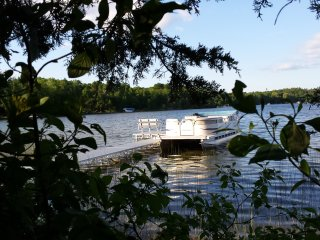 Beautiful lakefront home! boat, fishing, slps 14+ - Wautoma vacation rentals
