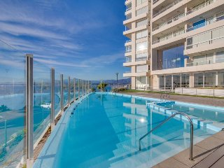 Stunning oceanview condo with access to a pool, hot tub, sauna, gym & more! - Concon vacation rentals