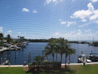 Luxury condo overlooking harbor with ocean view - Islamorada vacation rentals