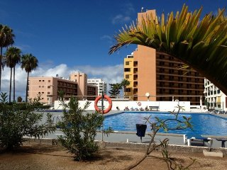 Nice Condo with Shared Outdoor Pool and Television - San Eugenio vacation rentals