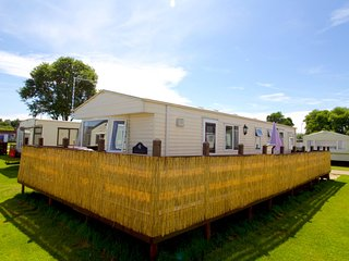 Ref 20034 8 berth caravan for hire with large decking at Broadland Sands. - Corton vacation rentals
