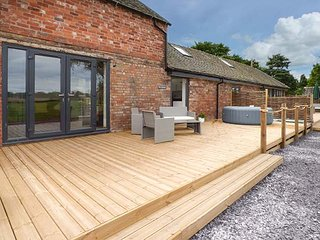 THE GRANARY, quality barn conversion, hot tub, decked area, countryside views - Hinstock vacation rentals