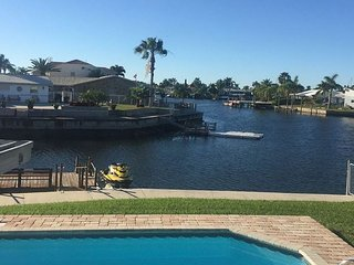 Wonderful canal front home with its own beach bar and heated pool! - New Port Richey vacation rentals