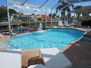 Villa Central - A Luxury Cape Coral 3b/3ba home w/electric heated pool/spa, gulf access canal, HSW Internet, Boat Dock, 2 Boat Lifts ( 20,000 lb and 4,000 lb ) - Cape Coral vacation rentals