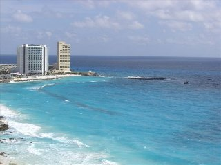 ULTRA LUXURY BEACHFRONT HIGHRISE CORNER UNIT. SALE - Cancun vacation rentals
