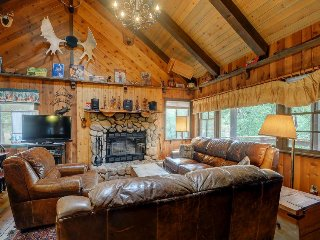 A vast, multi-level deck and rustic interior await at this cozy cabin - Big Bear Lake vacation rentals
