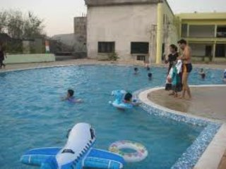 2BHK with NaturalWaterfall, Swim Pool & Rain Dance - Karjat vacation rentals