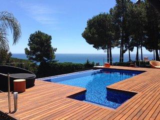 Spectacular design villa- ocean views in Barcelona and a sports motor boat - Sant Pol de Mar vacation rentals