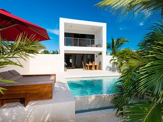Exquisitely designed & furnished, Sugar Kube is your tranquil new three-level, one bedroom, beach villa - Grace Bay vacation rentals