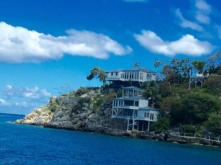 """One of the most astonishing rental homes on earth"" says Caribbean Travel & Life - West End vacation rentals"
