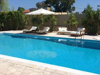 Modern, 4-bedroom house in Roitika with swimming pool and furnished terrace - steps from the beach! - Paralia vacation rentals