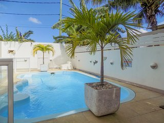 Modern, 2-bedroom apartment in Pereybere with a swimming pool, garden, WiFi and private balcony! - Pereybere vacation rentals
