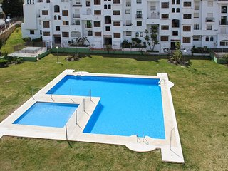 Traditional Andalusian apartment in Estepona with pool and sea view, near golf and beach – sleeps 6 - Estepona vacation rentals