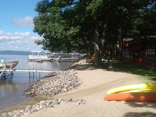 Log Cabin Rentals with fire places. 330' of lake front. Sandy beach. BEAUTIFUL - Houghton Lake vacation rentals