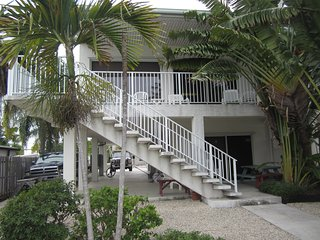 Spacious 4 Bedroom home on canal with Pool access at a private beach club. - Key Colony Beach vacation rentals