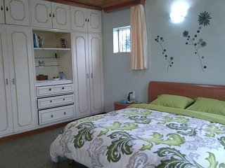 Cosy self contained room by the river with magnificent view of the UN grounds. - Nairobi vacation rentals