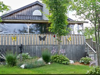 Familie Cottage with private lake & spa - Saint-Hermenegilde vacation rentals