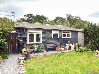 TY NI, detached, log cabin, woodburner, private garden, pet-friendly, nr - Caernarfon vacation rentals