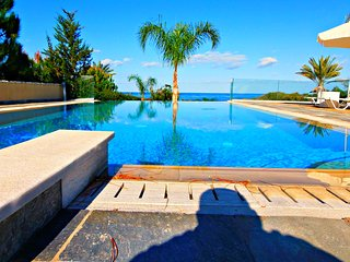 Beach Front Luxury Villa - Large Heated Infinity Pool with Amazing Sea Views - Polis vacation rentals
