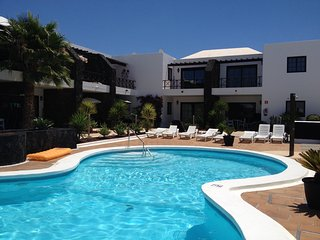 Pelicanos Club with free wifi both inside and beside the pool! - Puerto Del Carmen vacation rentals