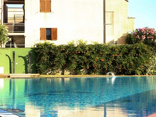Bright Condo with Shared Outdoor Pool and Television - Pignone vacation rentals