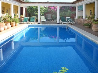 Roman-style courtyard living in Andalucia, villa with private pool at its heart - La Carlota vacation rentals