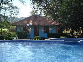 2 bedroom house with communal pool in lush tropical garden - Playa Potrero vacation rentals