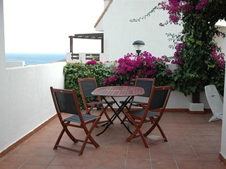 Poolside apartment with sea view - San Luis de Sabinillas vacation rentals