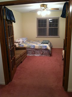 1 bedroom suite with a queen bed, sofa, chair and desk and an attached bath - Dayton vacation rentals